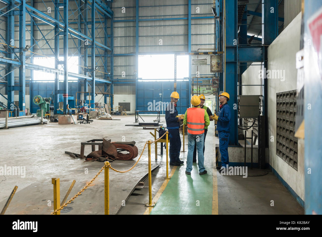 Group of four workers talking during break - Stock Image
