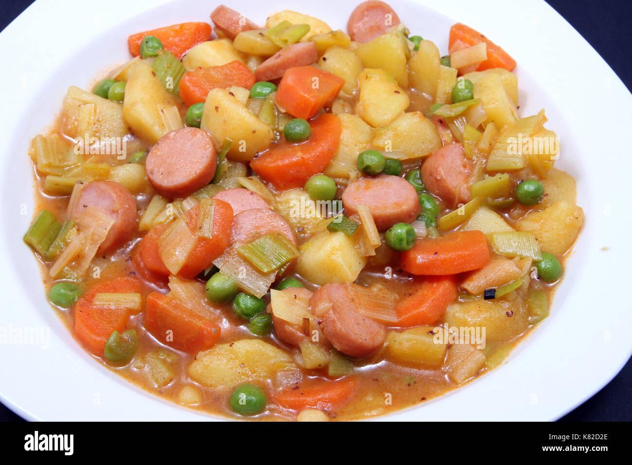 kartoffeleintopf mit bohnen auf weißen teller, potato stew with beans on white plate Stock Photo
