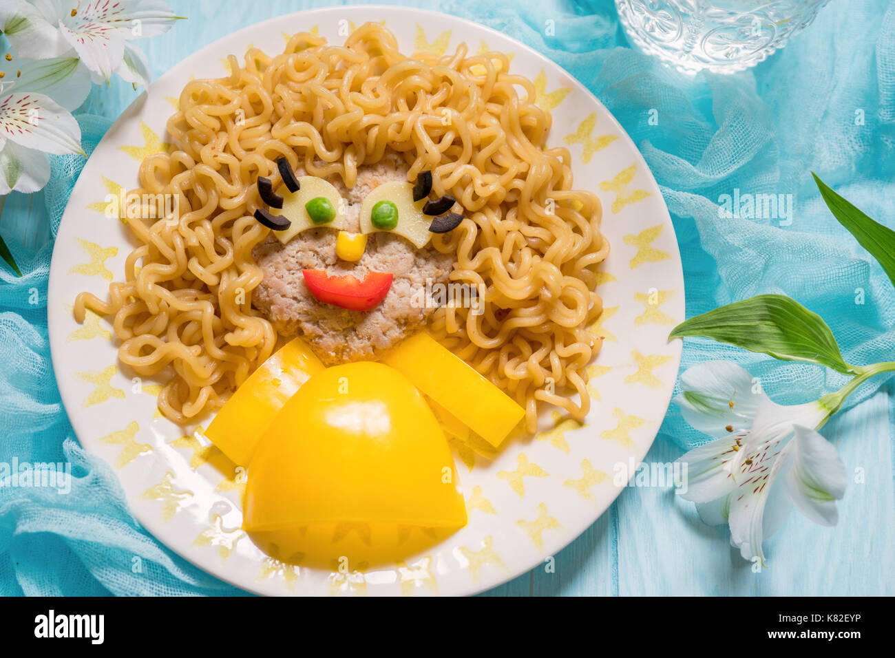 Funny Food Face with Cutlet, Pasta and Vegetables - Stock Image
