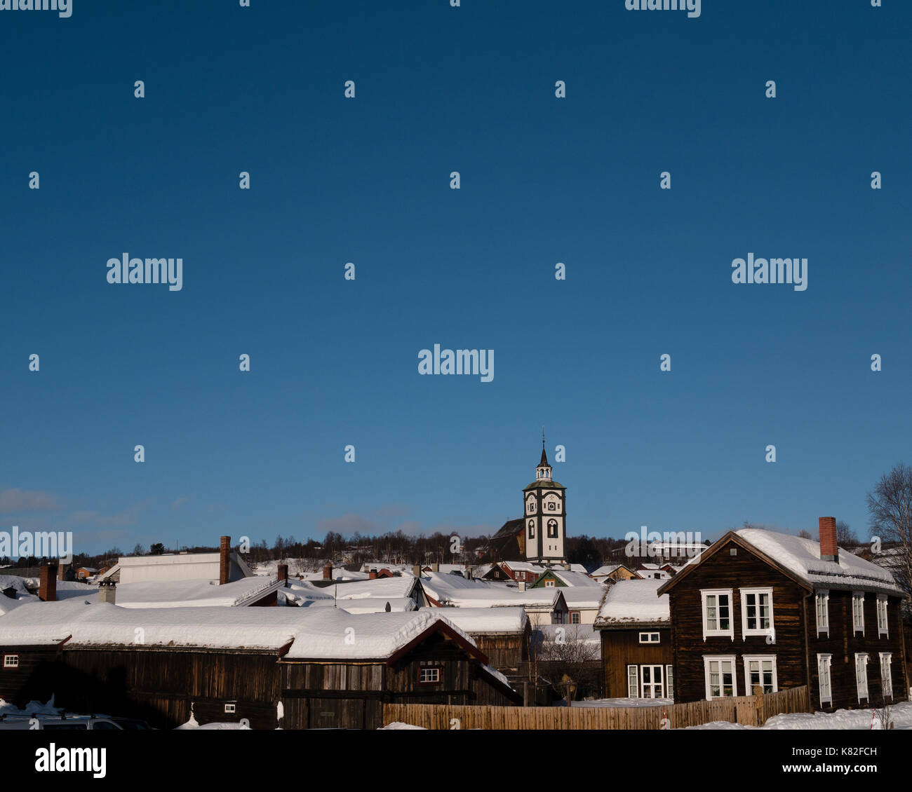Church of Röros overlooking the old historic city center. - Stock Image