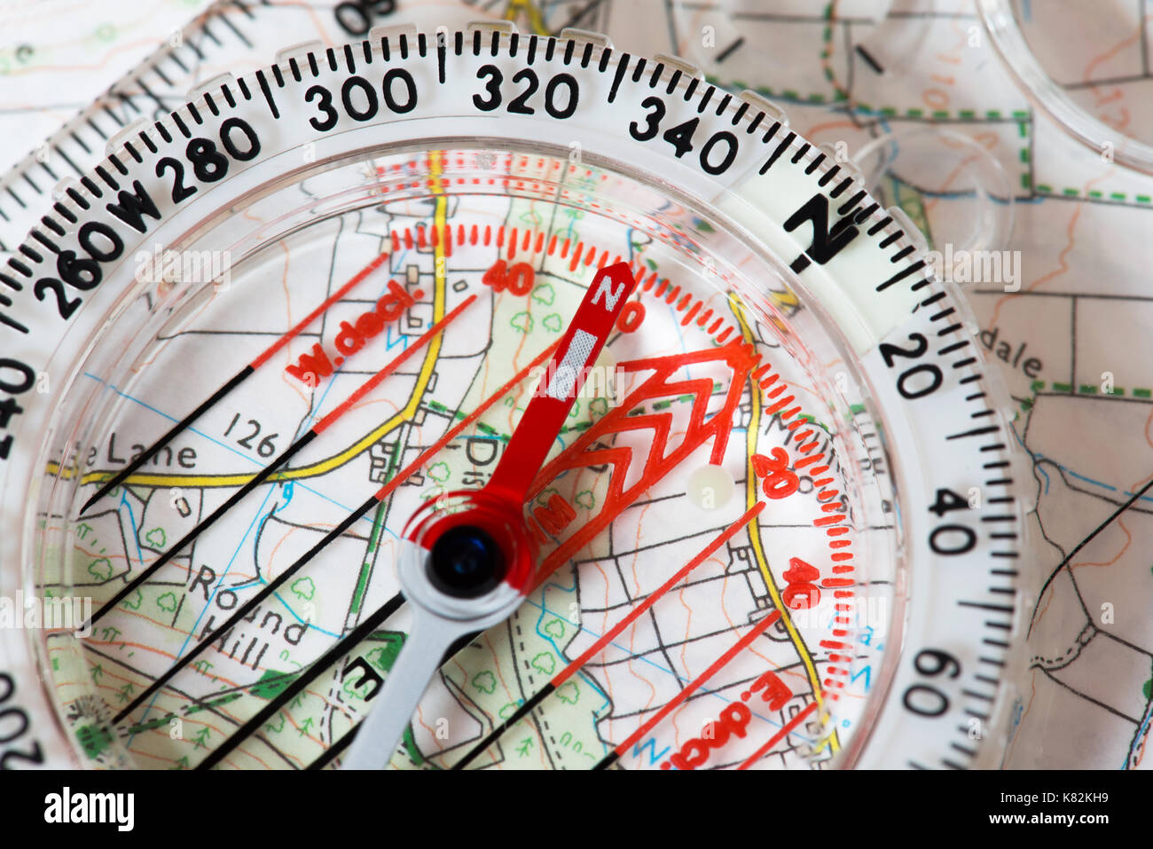 Close up of a map and compass - Stock Image