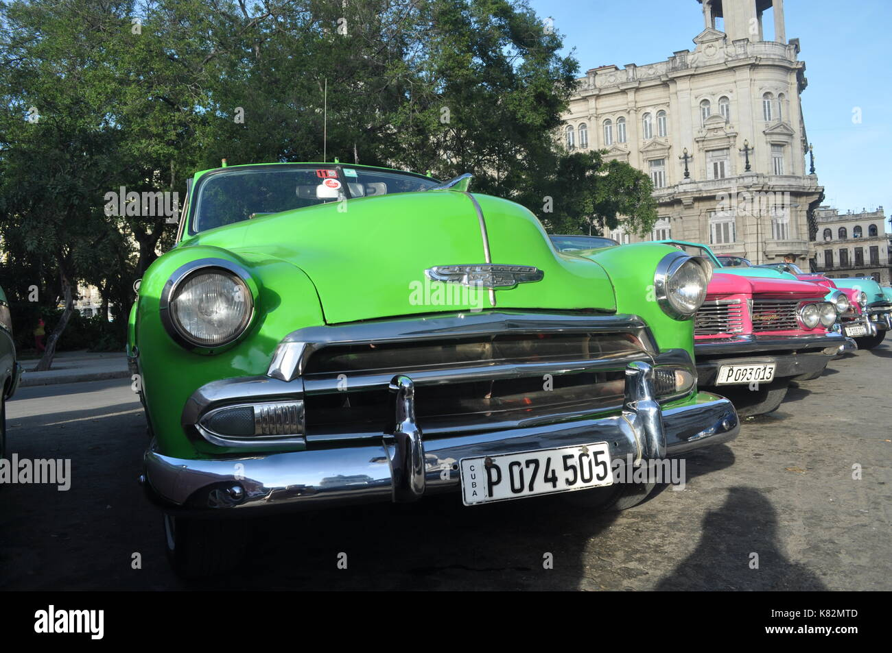 Vintage cars parked at old Havana square in Cuba - Stock Image