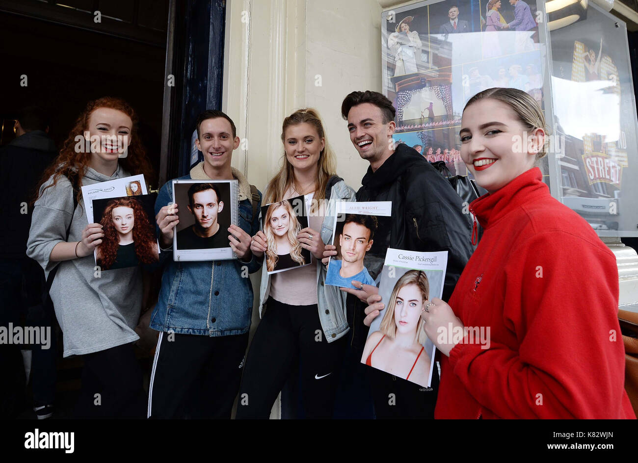 People queue outside Theatre Royal Drury Lane in London as auditions opened for the musical 42nd Street. - Stock Image