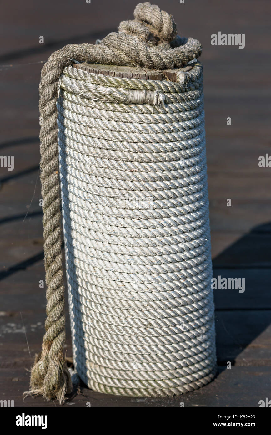 Nautical rope wrapped in spiral on mooring pole Stock Photo
