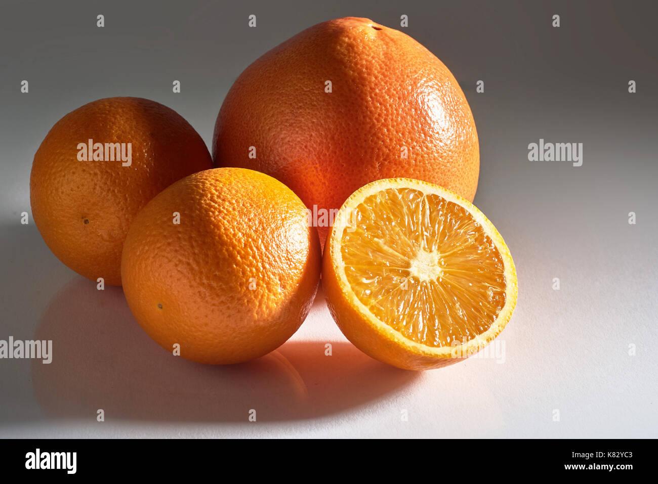 Delicious fresh oranges isolated on white background. - Stock Image