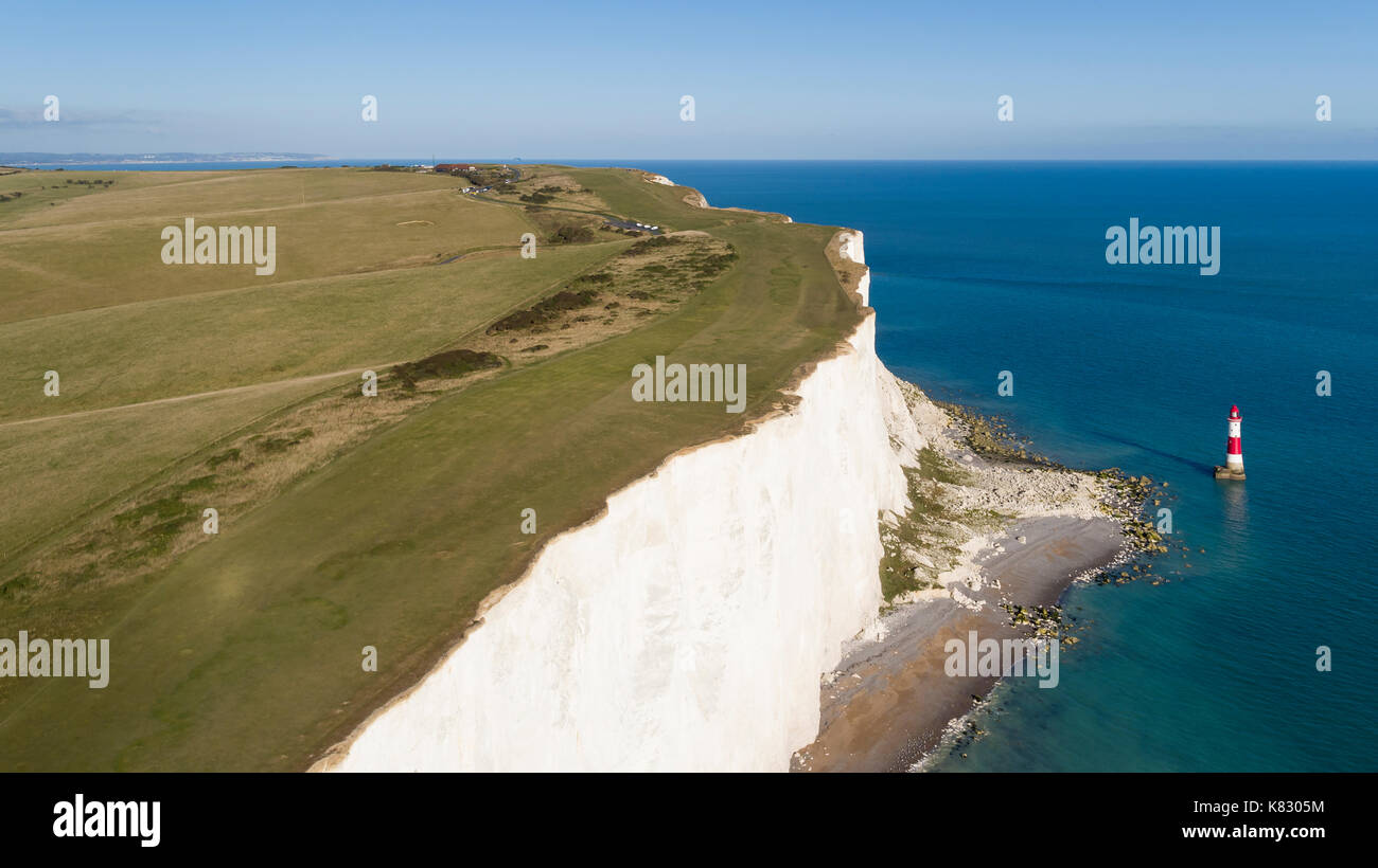 United Kingdom, East Sussex, Eastbourne, Beachy Head lighthouse, Seven Sisters coastline, white chalk cliffs of Beachy Head - Stock Image