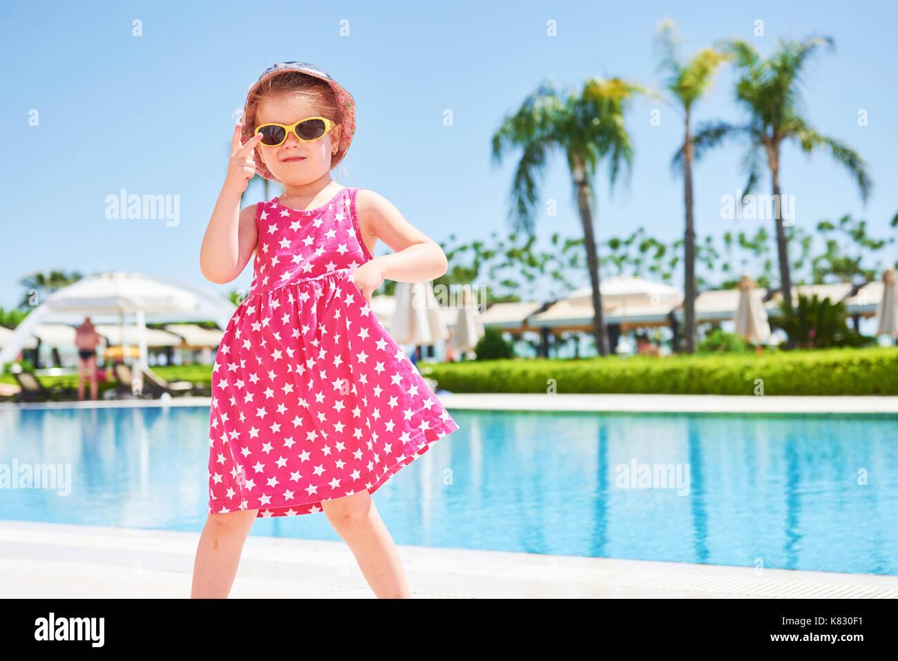 Portrait of a happy girl outdoors in summer day. Amara Dolce Vita Luxury Hotel. Resort. Tekirova-Kemer. Turkey. - Stock Image