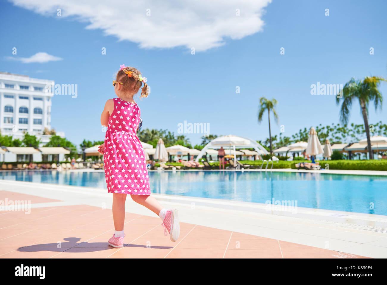 Portrait of a happy girl outdoors in summer day. Amara Dolce Vita Luxury Hotel. Resort. Tekirova-Kemer. Turkey. Stock Photo