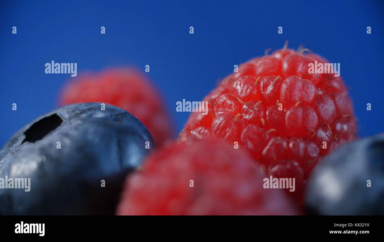 Fresh fruits - blueberry, raspberry. beautifully lined with raspberries and blueberries - Stock Image