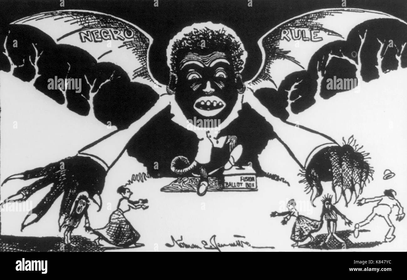 Cartoon used in the campaign for the ratification of the North Carolina disfranchising constitution: shows hideous Negro vampire bat 'Negro Rule' rising from a 'fusion (3rd party) ballot box'. Political Cartoon, 1900 - Stock Image