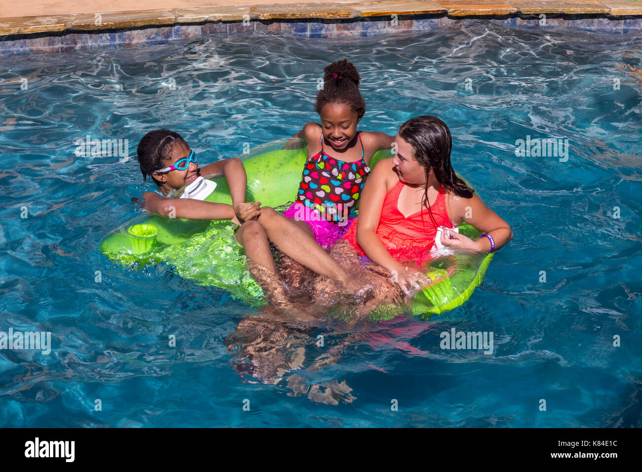 girls, children, swimmers, swimming, swimming pool, freshwater swimming pool, pool party, Castro Valley, Alameda County, California, United States - Stock Image