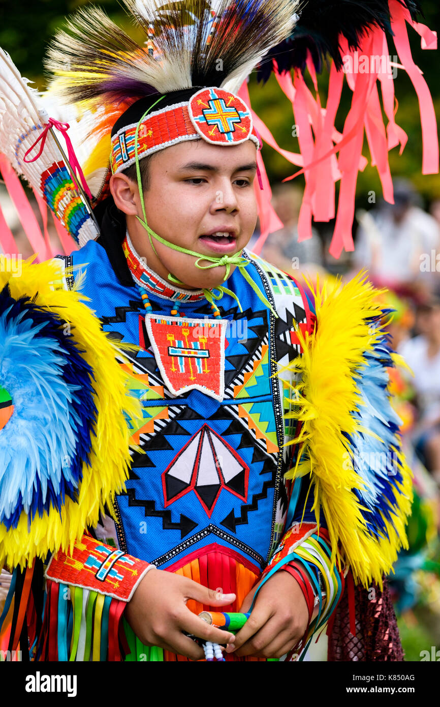 cb846292c5ba3 First Nations teenager boy fancy dancer dressed with colourful regalia to  perform the grass dance during a Pow Wow in London, Ontario, Canada.