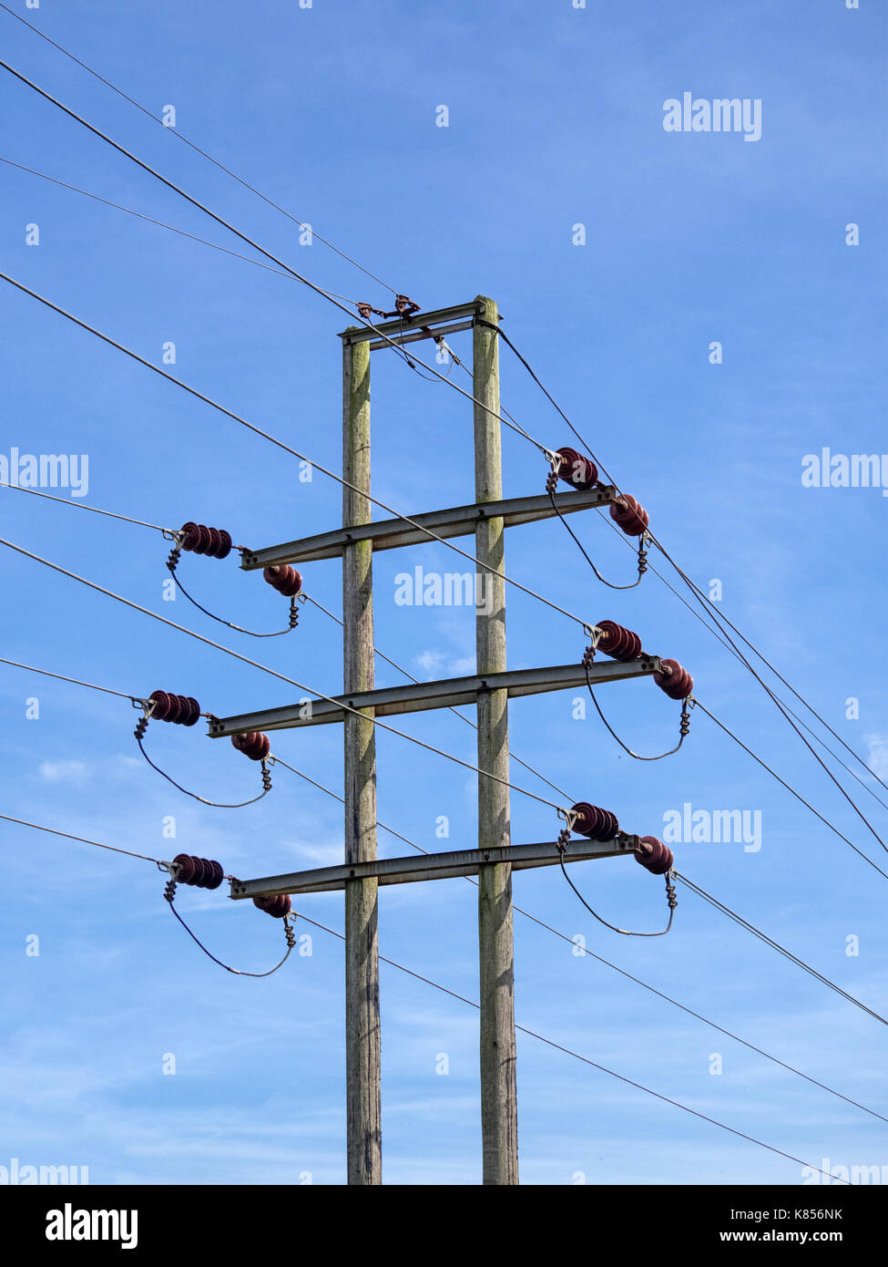 ELECTRICITY POWER PYLON:  Seen against Blue Sky - Stock Image