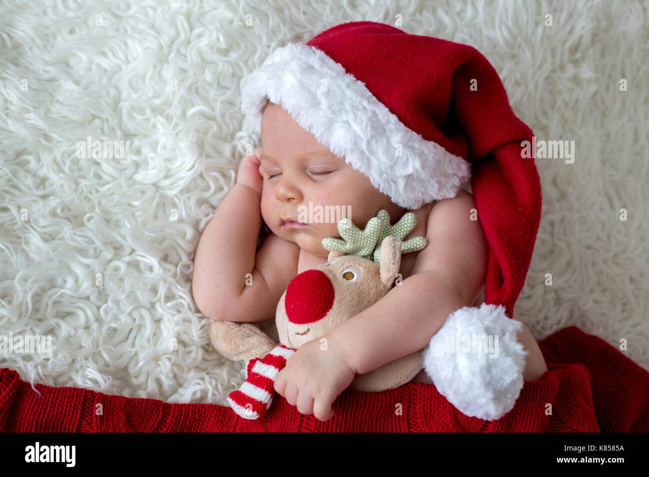 3c43d451f Little sleeping newborn baby boy, wearing Santa hat and pants Stock ...