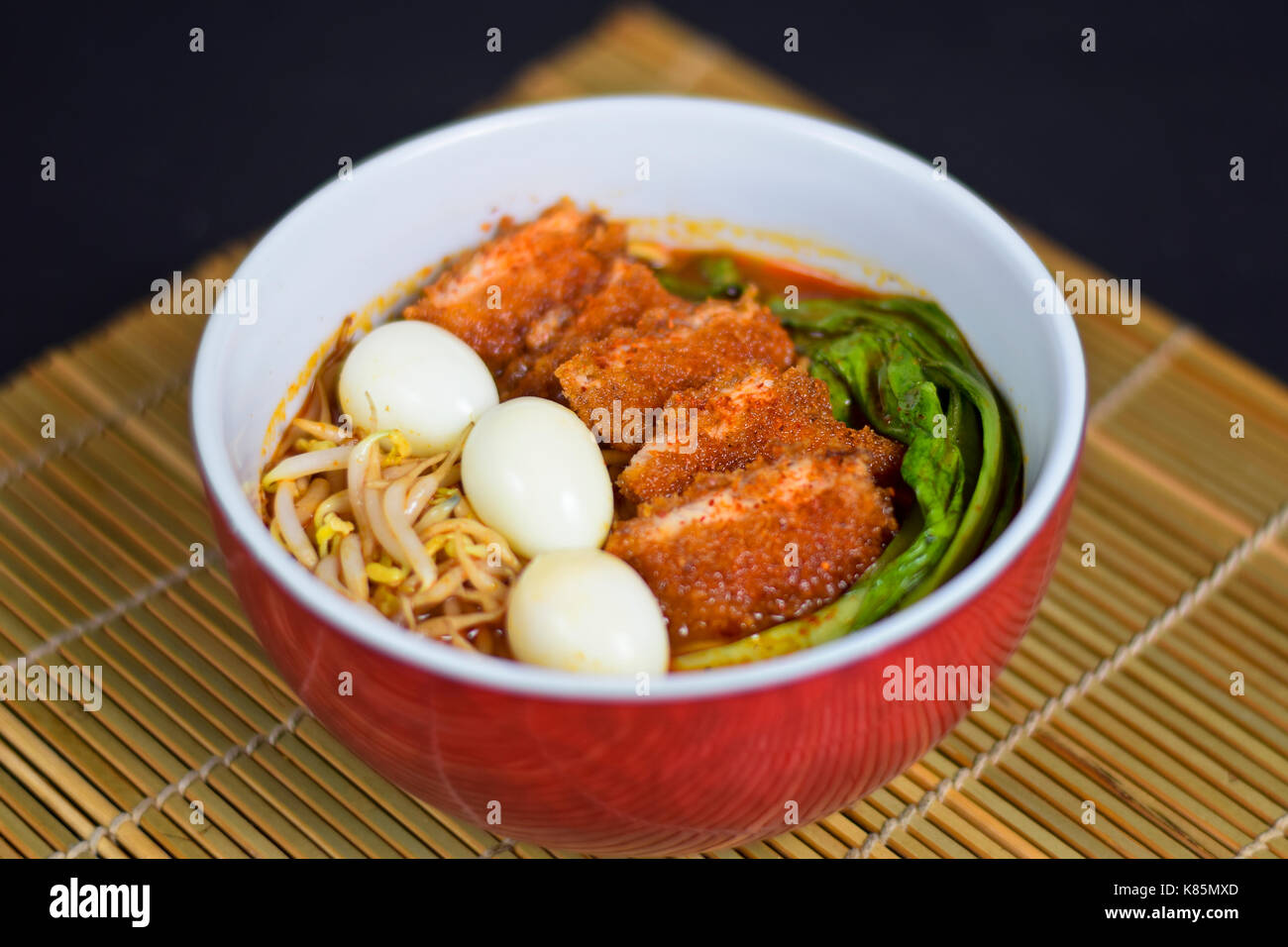 Ramen noodles with extra fried bacon - Stock Image