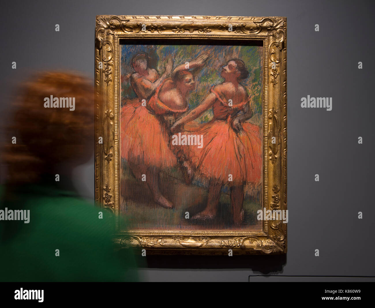 National Gallery, London, UK. 18th Sep, 2017. Degas artworks from the Burrell Collection in Glasgow go on display at the National Gallery from 20 September 2017 - 7 May 2018. Shipping magnate Sir William Burrell gifted his large collection of art, including one of the finest collections of Degas pastels in the world, to the City of Glasgow in 1944. Hilaire-Germain-Edgar Degas. Photograph: The Red Ballet Skirts, about 1900. The Burrell Collection, Glasgow. Glasgow Museums Collection. Viewed by a member of Gallery staff. Credit: Malcolm Park/Alamy Live News. - Stock Image