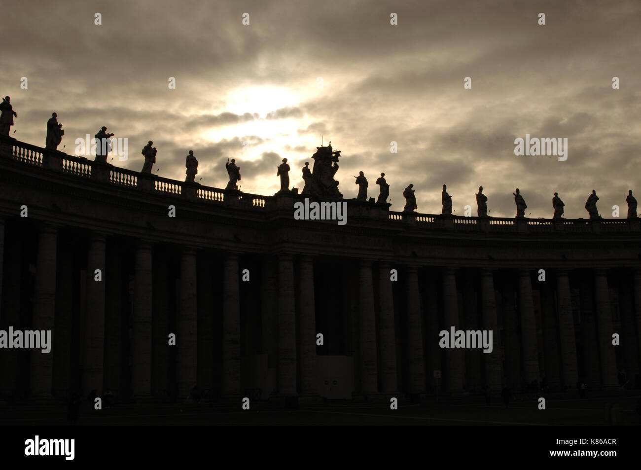 Vatican city. Great colonnade of Saint Peter square, by Bernini, 17th century. Detail. Backlighting. - Stock Image