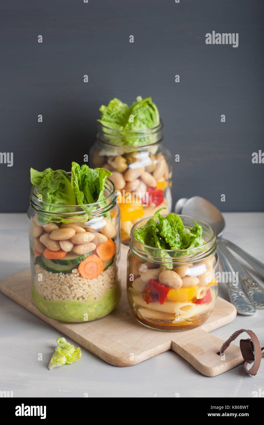 vegan couscous and pasta salad in mason jars with vegetables beans Stock Photo