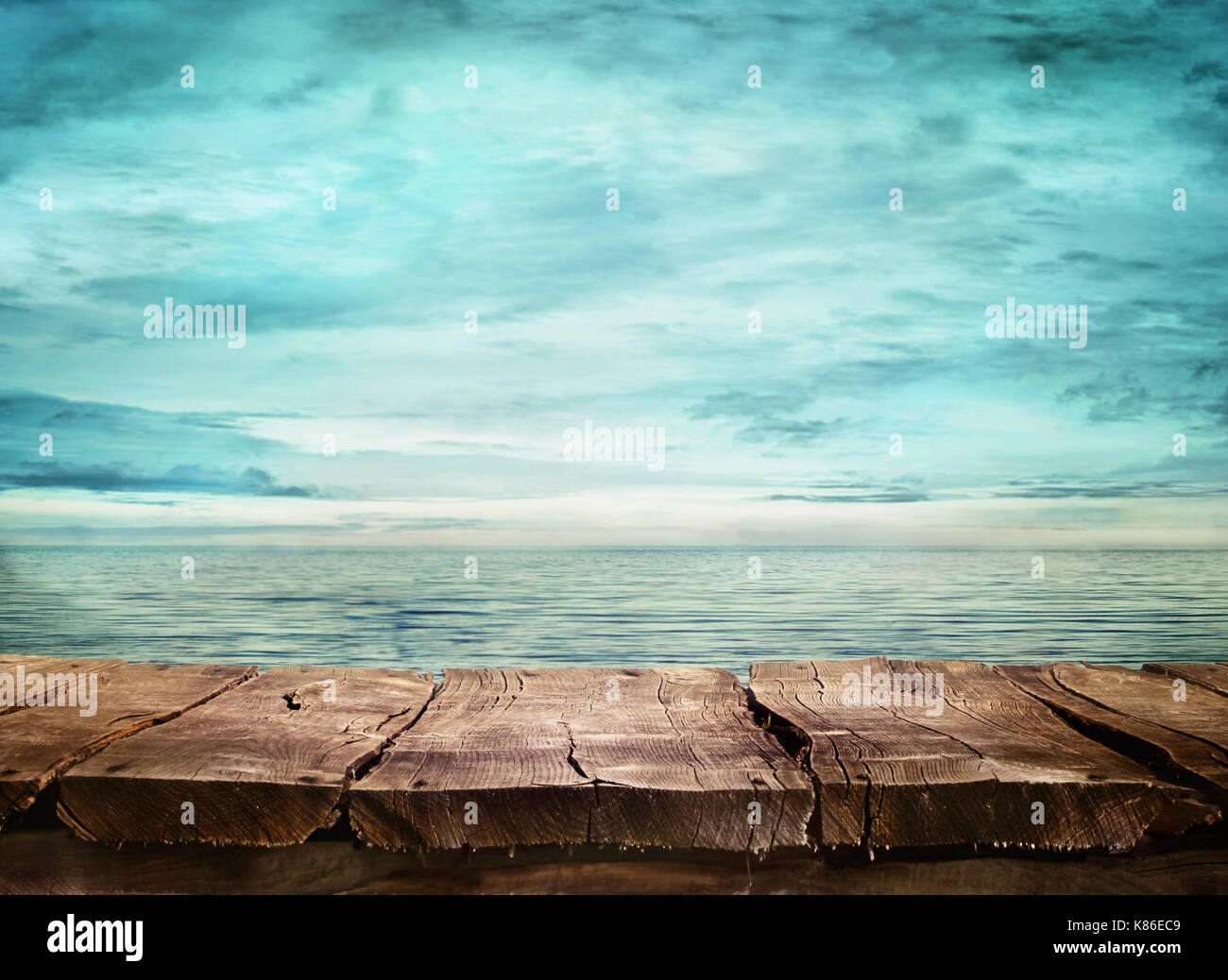 Wood table and tropical landscape in the background.. Spring or summer abstract nature background. - Stock Image