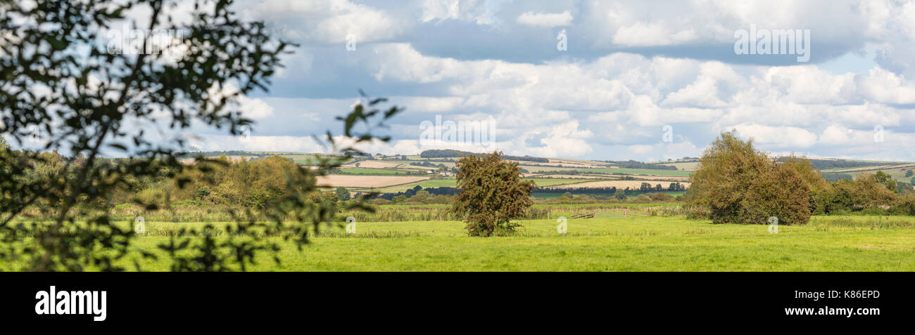 South Downs countryside panoramic with cloudy sky and fields taken in Autumn from Arundel, West Sussex, England, UK. - Stock Image