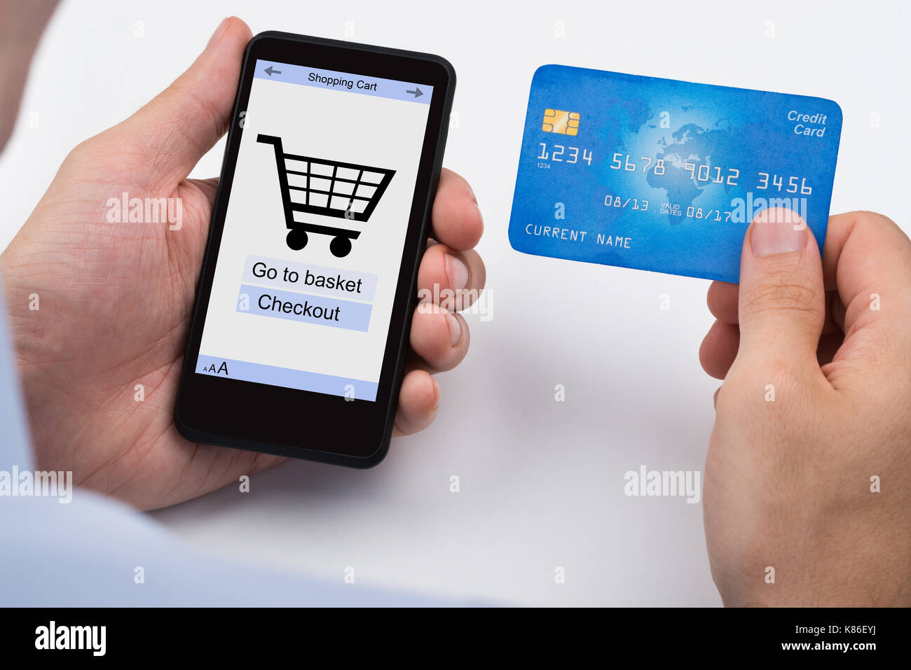 dbd3f905929 Close-up Of Person Shopping Online With Credit Card On Mobile Phone ...