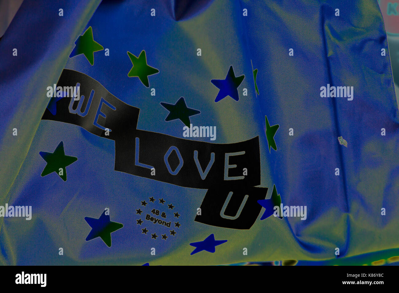 We Love U flag 48 & Beyond at Stop Brexit Demonstration at Bournemouth, Dorset in September - solarised - Stock Image