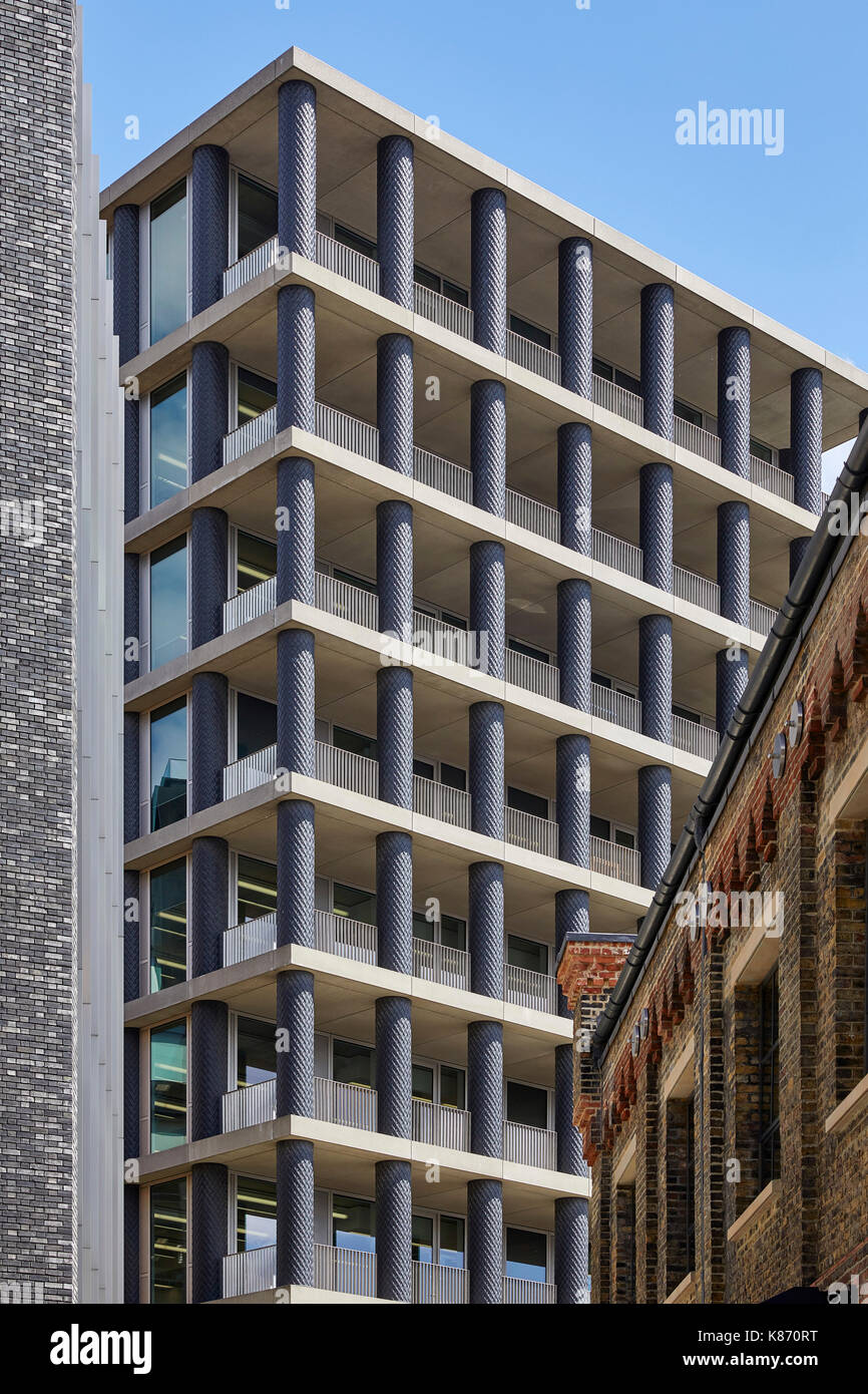 View between buildings  of the Iron columns of One Pancras Square, David Chipperfield Architects. King's Cross Estate, London, United Kingdom. Archite - Stock Image