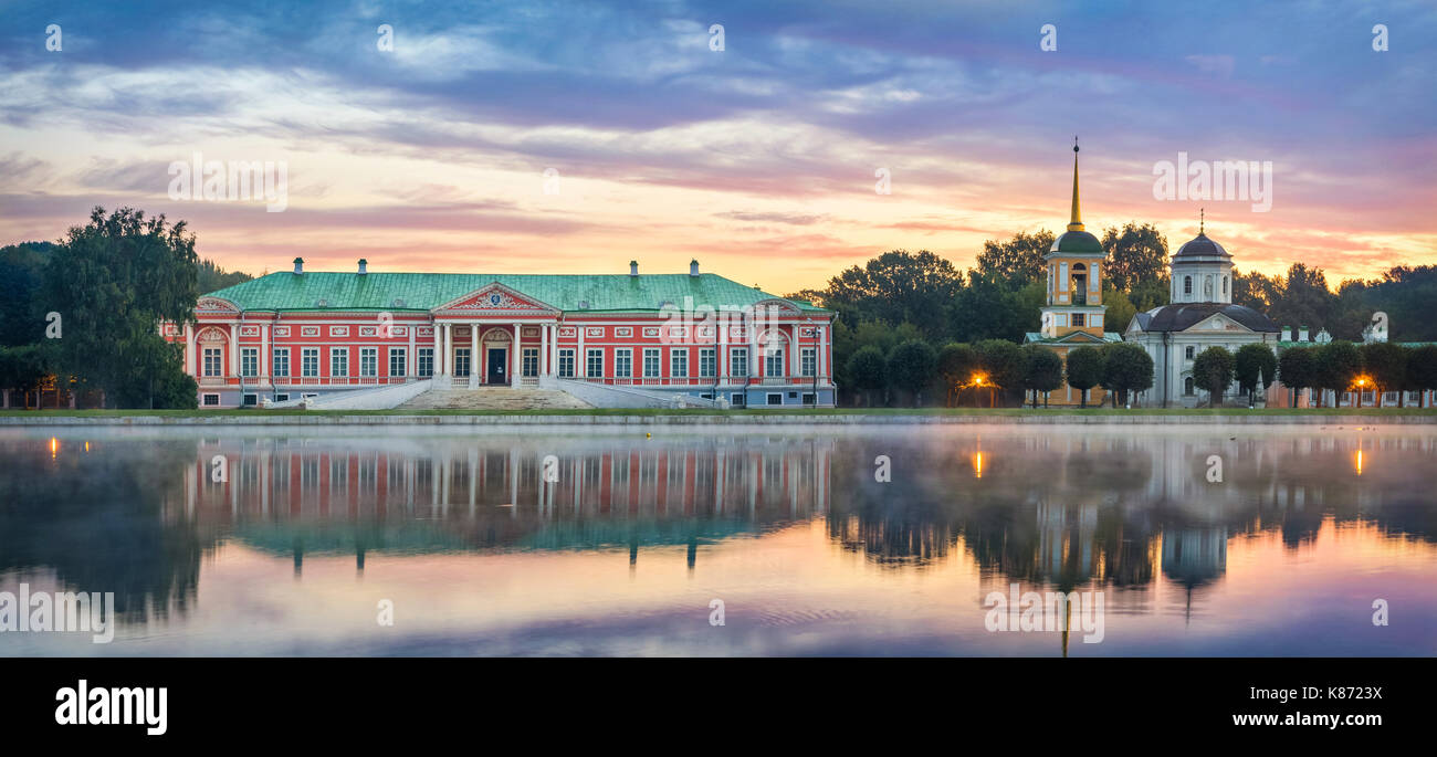 Panorama of Kuskovo estate with reflection in water on sunrise in Moscow, Russia - Stock Image