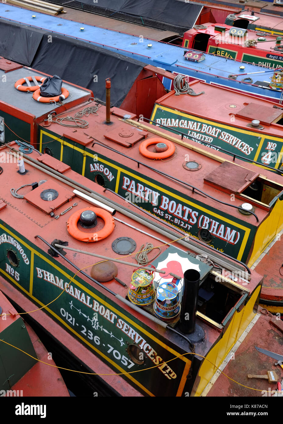 narrow boats in Gas Street Basin, on the historic canal network in Birmingham, England - Stock Image