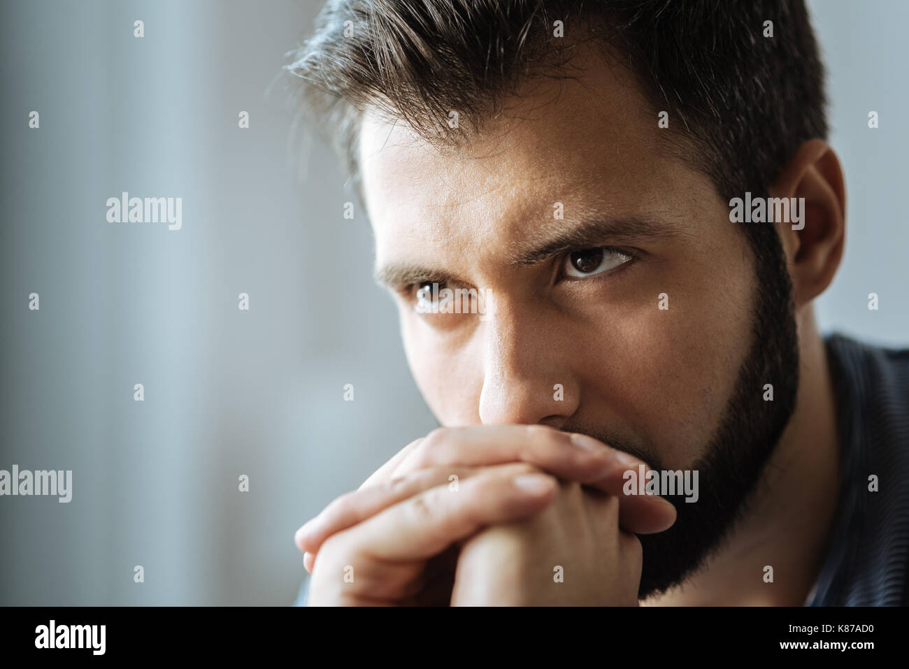 Portrait of an unhappy thoughtful man - Stock Image