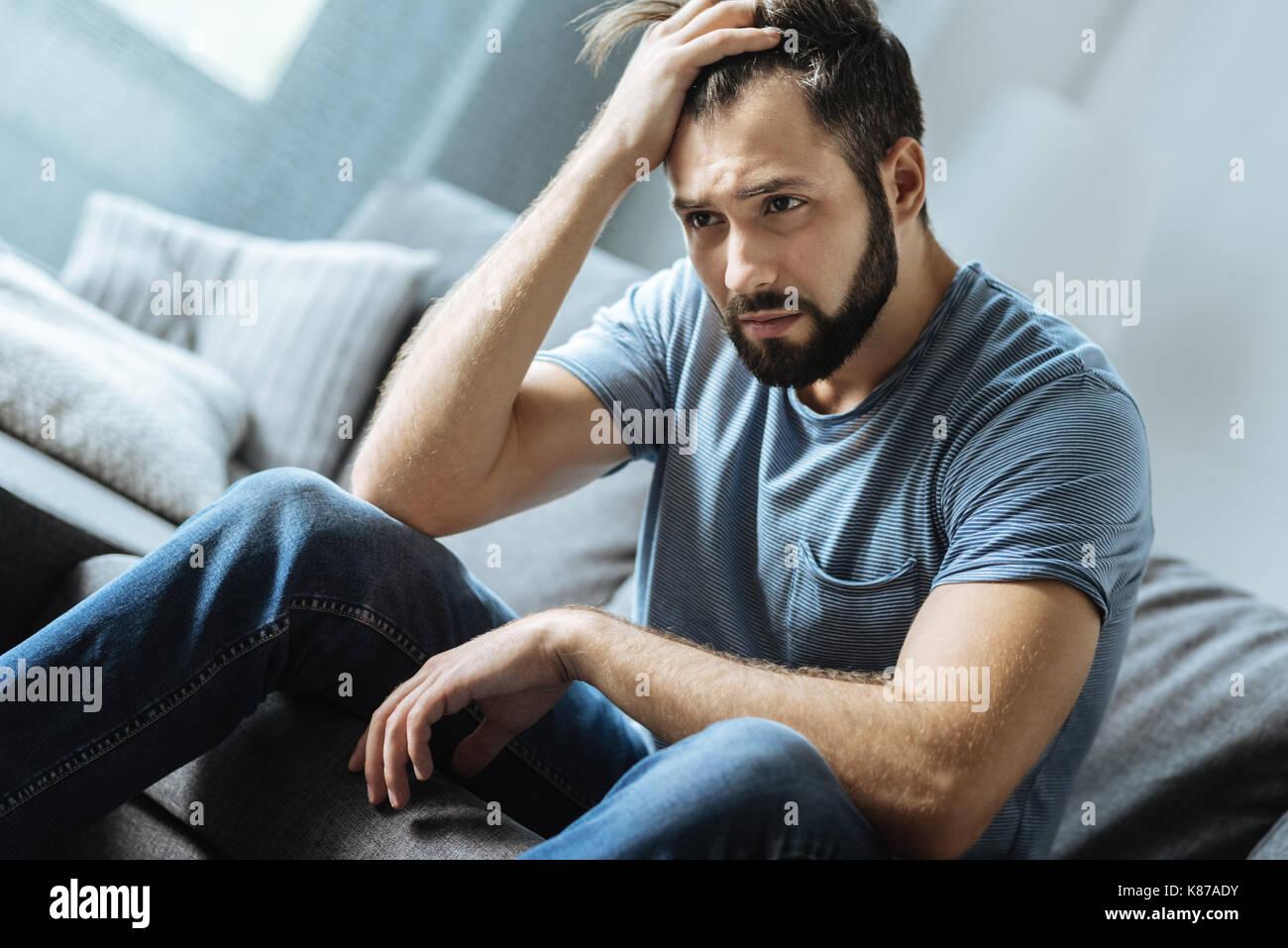 Cheerless moody man being alone - Stock Image