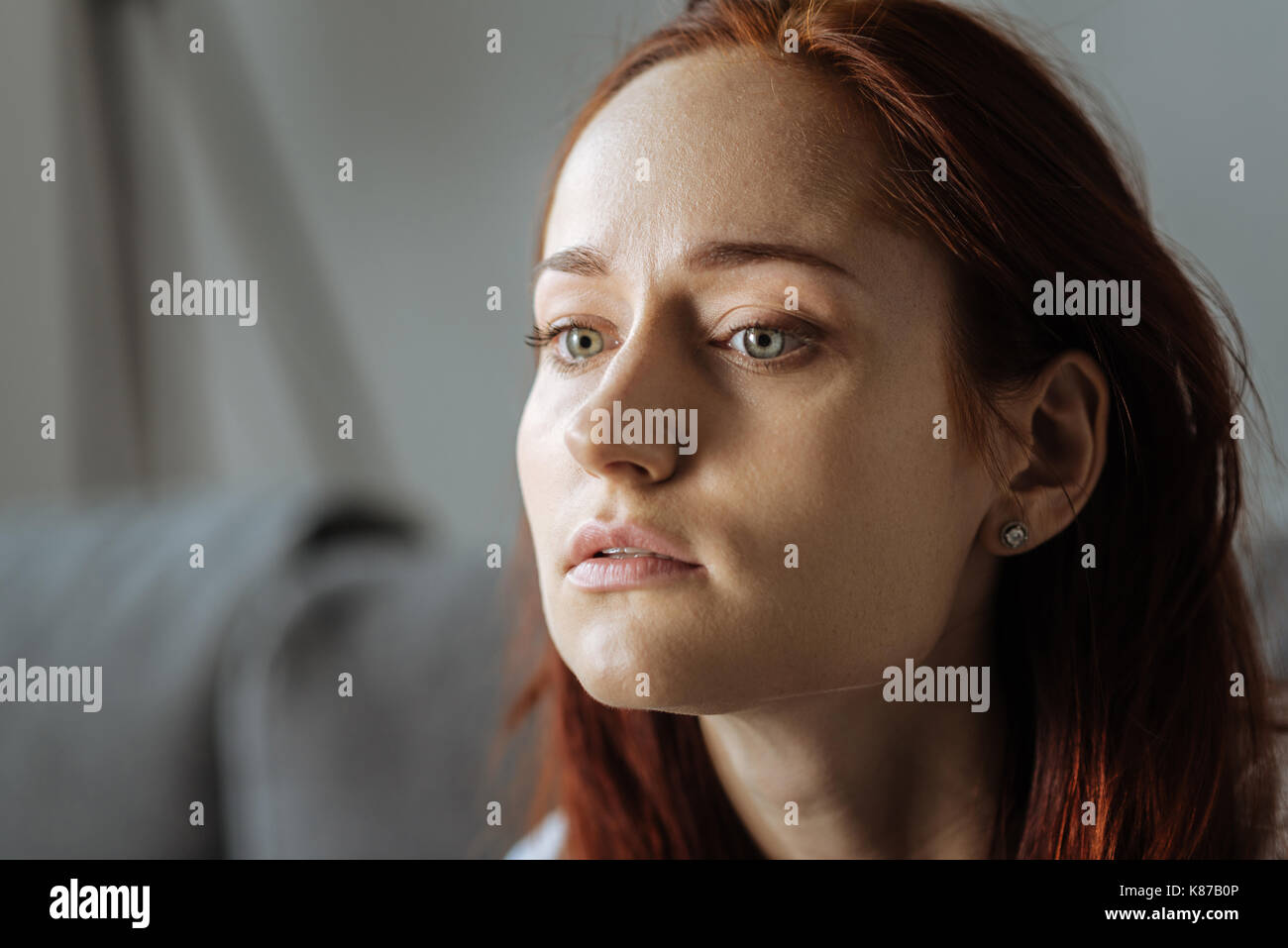 Sad moody woman suffering from depression - Stock Image
