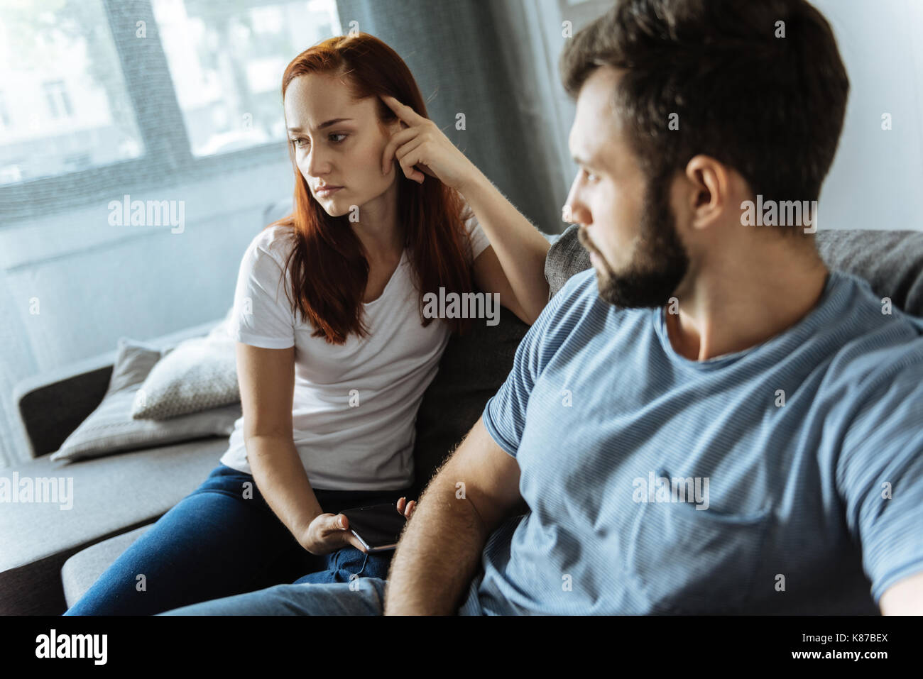 Cheerless young couple having an argument - Stock Image