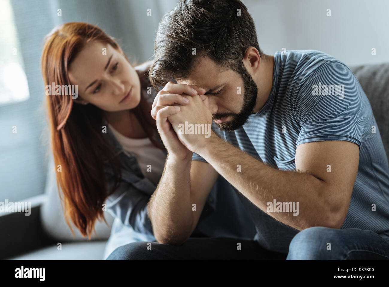 Cheerless thoughtful man dealing with a problem - Stock Image