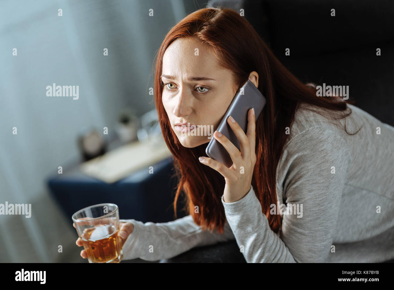 Cheerless gloomy woman making a call - Stock Image