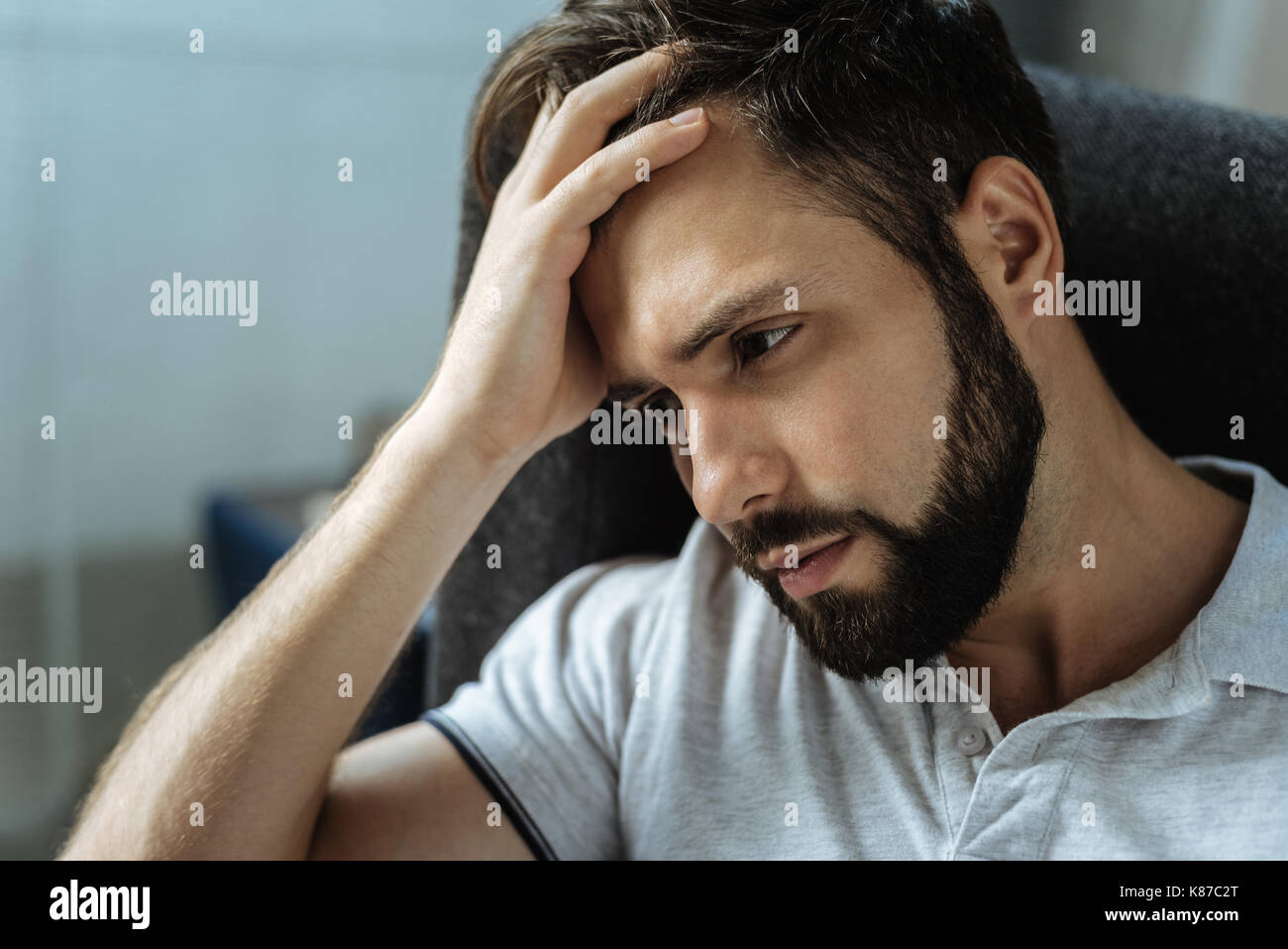 Sad bearded man feeling frustrated - Stock Image
