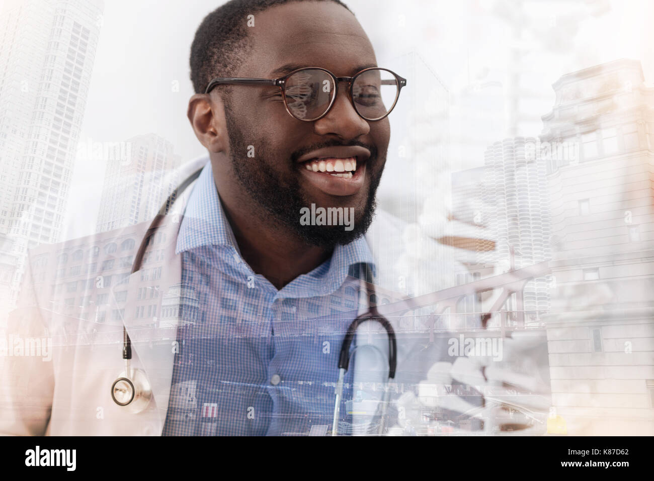 Optimistic skilled doctor smiling broadly - Stock Image