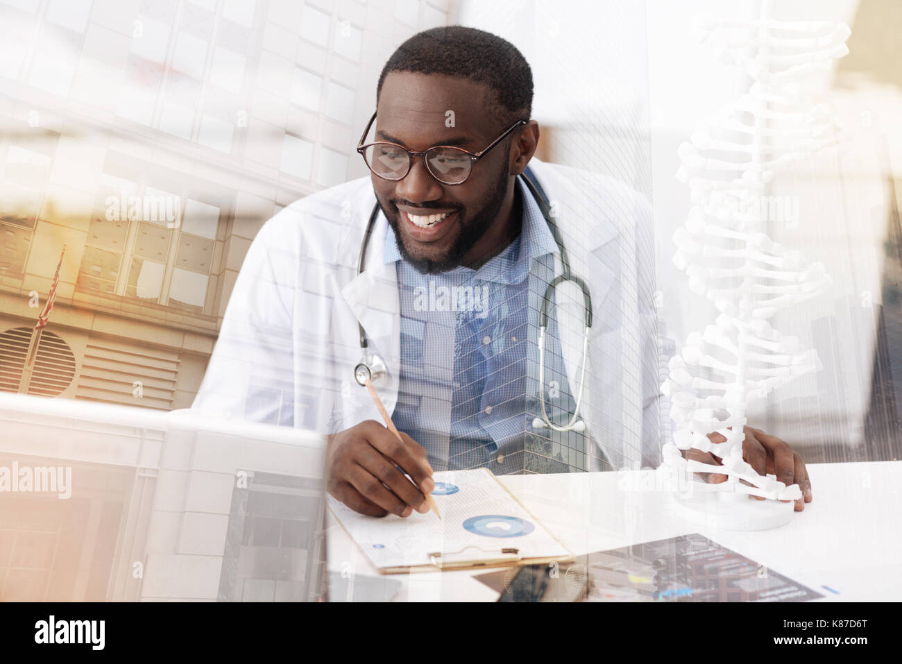 Delighted doctor working with notes Stock Photo