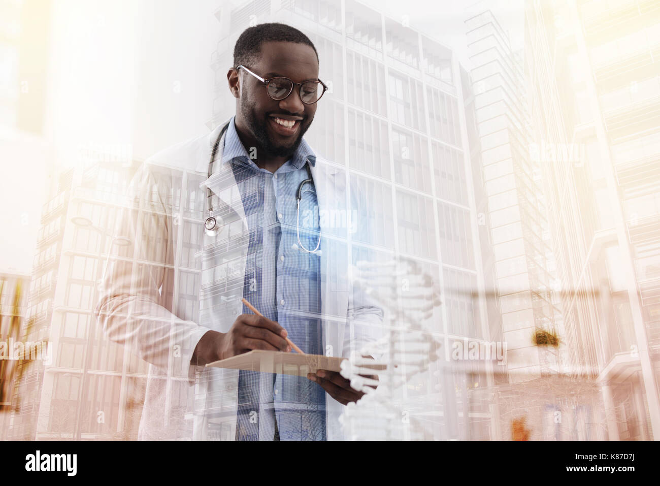 Experienced doctor busy with documents - Stock Image