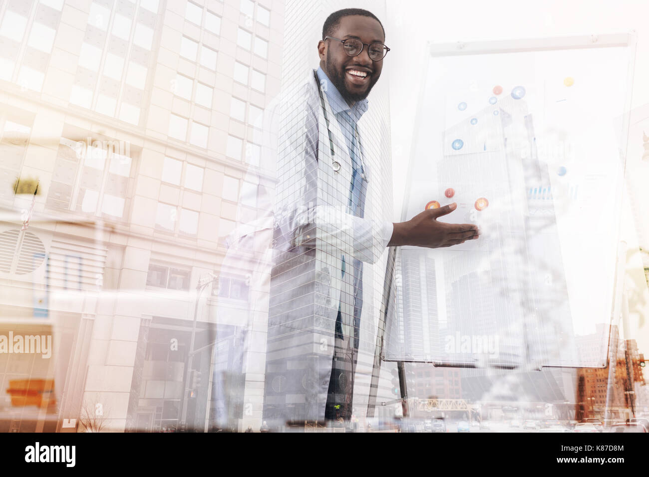 Cheerful doctor talking about biotechnology - Stock Image