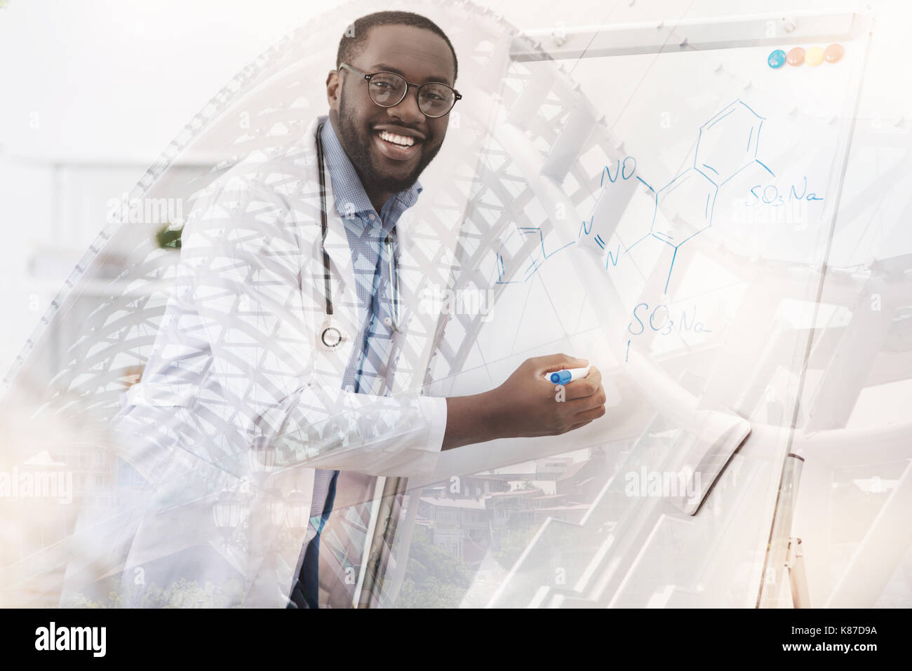 Excited chemist using marker pen - Stock Image