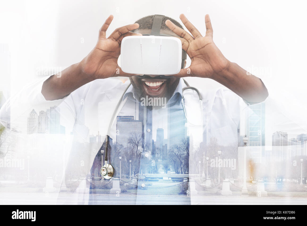 Happy African American doctor wearing virtual glasses - Stock Image