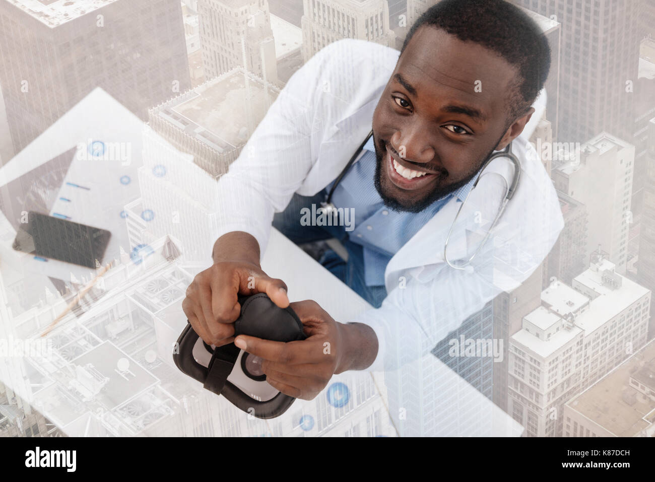 Professional chemist looking at you with delight - Stock Image