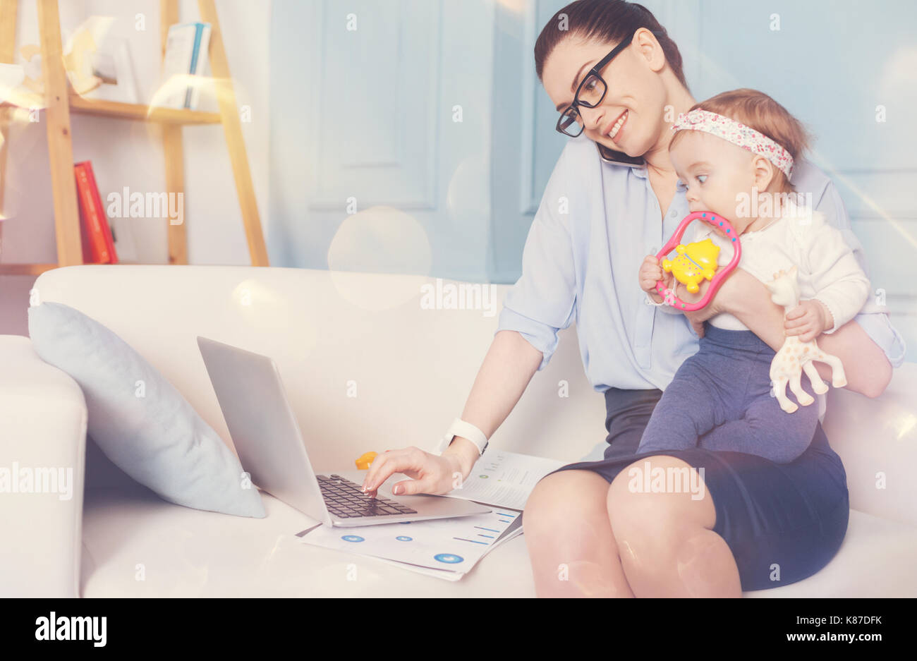 Positive delighted female keeping smile on face - Stock Image