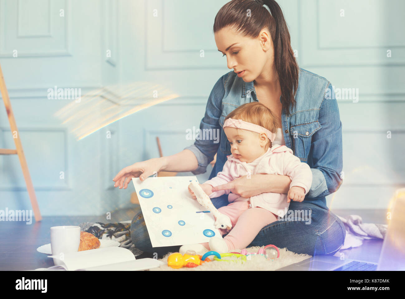 Very attentive woman looking at documents - Stock Image