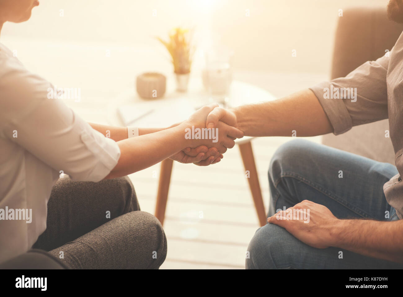 Pleasant nice people greeting each other - Stock Image