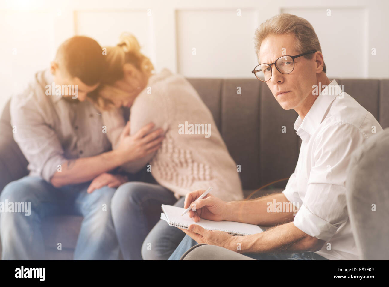Intelligent male psychologist looking at you Stock Photo