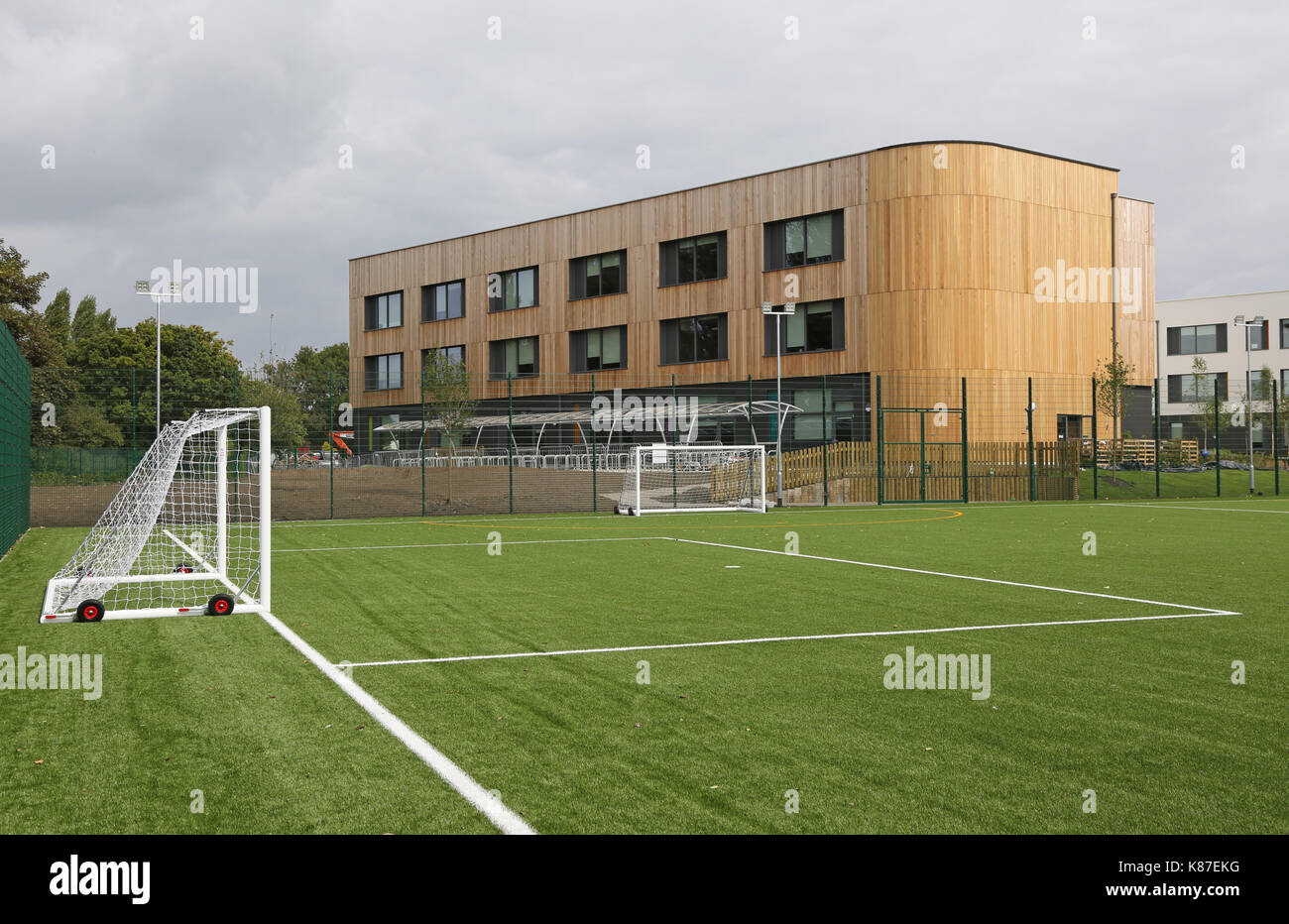 An artificial grass all-weather football pitch at a new secondary school in Slough, UK Stock Photo