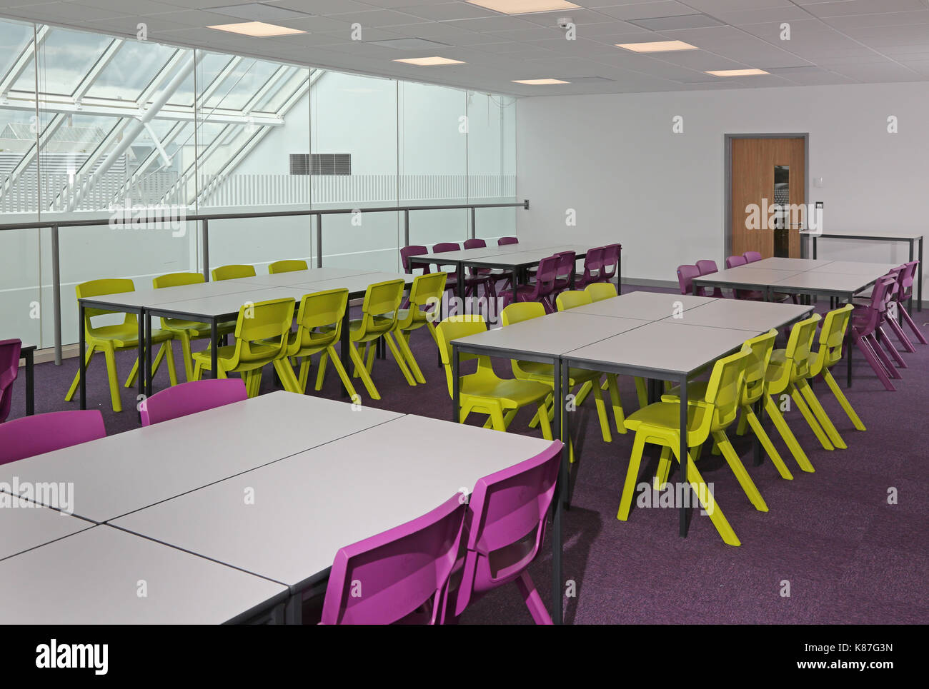 A modern classroom in a new London secondary school converted from a modern office building. Shows teaching space overlooking a large atrium. - Stock Image