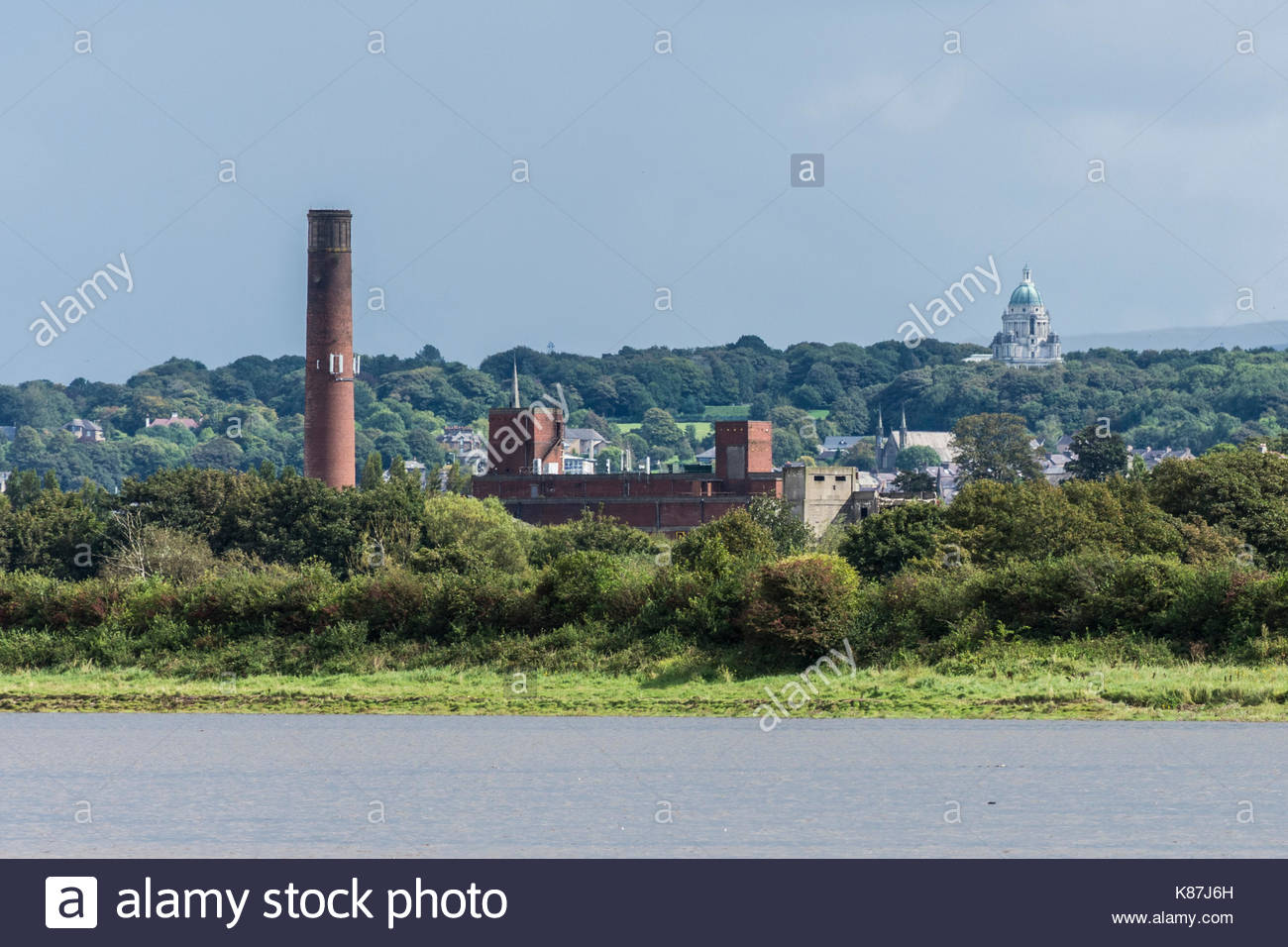 Disused factories and the Ashton memorial on the Lancaster skyline - Stock Image